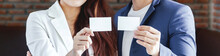 Business Persons Show Blank Business Cards
