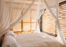 White Gauze Curtains On Canopy Bed In Tranquil Modern, Luxury Home Showcase Interior Bedroom