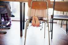Cute, Barefoot Girl Kneeling O...