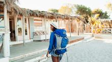 Young Female Backpacker Arrivi...