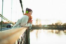 Carefree Woman Listening To Mu...