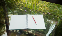 Open Blank Notebook And Pencil...