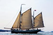 Ship With Netherlands Flag Sailing On Sunny Atlantic Ocean Greenland