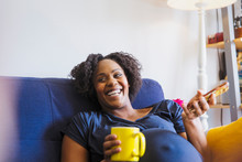 Laughing Pregnant Woman With T...