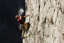 Male Rock Climber Scaling Rock...