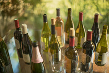 Variety Of Wine Bottles On Table