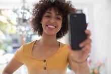 Happy Young Woman Taking Selfi...