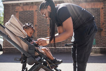 Father Fastening Toddler Son I...