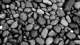 Fototapeta Kamienie - black stone background, pebbles beach