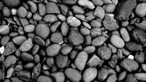 black stone background, pebbles beach Wallpaper Mural