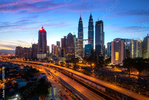 Fototapety, obrazy: Kuala Lumpur city skyscraper and highway street with nice sky sunrise at downtown business district in Kuala Lumpur. Malaysia. Malaysia tourism, modern city life, or business finance and economy