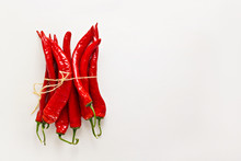 Red Chili Peppers On Light Gra...