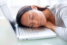 Young Woman Asleep On Laptop