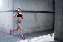 Woman Wearing Headphones Running
