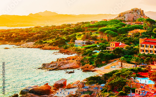 Landscape and scenery of Baja Sardinia luxury resort in Costa Smeralda at sunset evening, Sardegna island in Italy in summer Canvas Print