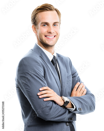 Cuadros en Lienzo Portrait picture of happy smiling businessman in grey confident suit, crossed hands, isolated on white background