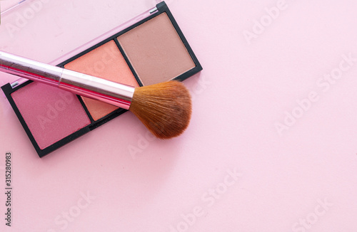 Valokuvatapetti Blush compact pallete kit against pink background, copy space