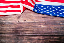 American Flag On Wooden Backgr...