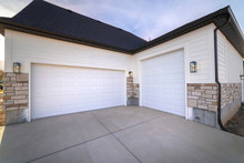 Two Garage Doors Sharing A Pav...