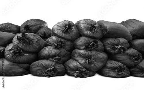 black trash bag pile up and isolated on white background Canvas-taulu