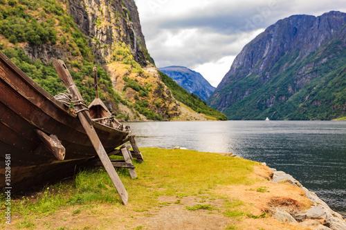 Fototapeta Old viking boat on fjord shore, Norway obraz