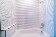 Clean White Tiled Shower Combi...