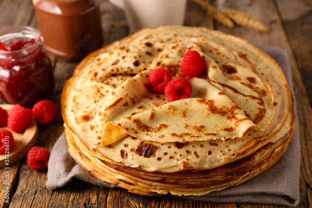 Fototapeta stack of crepe with raspberry and chocolate