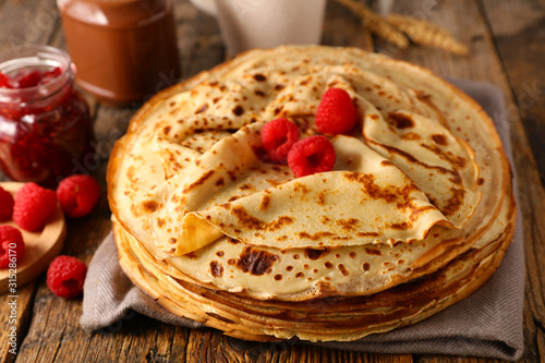 stack of crepe with raspberry and chocolate - 315286170