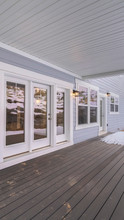 Vertical Frame Wooden Deck On A Covered Exterior Patio In Winter