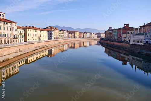 View from a bridge over Arno river in Pisa Wallpaper Mural