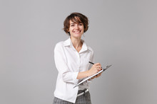 Smiling Young Business Woman In White Shirt Posing Isolated On Grey Wall Background. Achievement Career Wealth Business Concept. Mock Up Copy Space. Hold Clipboard With Papers Document, Writing Notes.