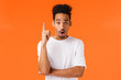 canvas print picture - Guy have great idea. Attractive african-american young college student raise index finger in eureka gesture, saying his plan, found solution, answer question, suggest resolve, orange background
