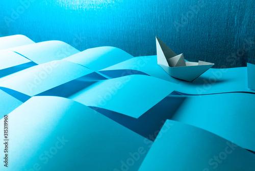 Fotografía Paper ship in the paper sea. Concept of the theme of bureaucracy.