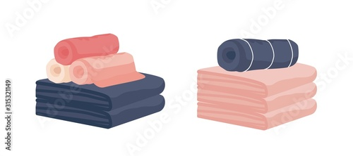 Fotografia  Realistic colorful hand and bath fabric towels rolled isolated on white background