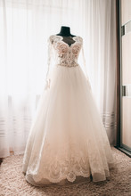 White Wedding Dress On Mannequin