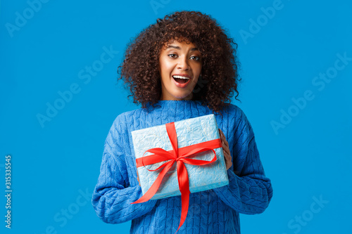 Girl cant wait unwrap gifts on winter holiday season Canvas-taulu