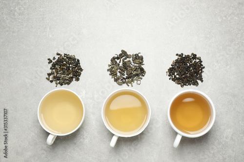 Fototapeta Flat lay composition with green tea on grey table obraz