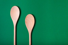 Empty Wooden Spoons On Green B...