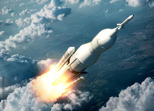 Fototapeta Space Launch System Flying Over The Clouds