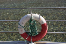 Lifebuoy Hanging On The Wall Of The Pier On The Background Of Water
