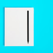 Mockup of closed blank square book and black pencil at colored textured paper background