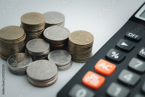 Fotomural  copy space , money coins and stationary in white color style for money , banking