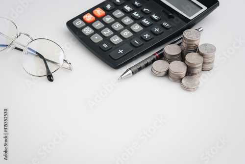 Fotografía  copy space , money coins and stationary in white color style for money , banking