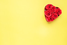 Red Rose Flowers In The Shape Of A Heart On A Yellow Background.he Concept Of Valentine's Day, Wedding Romance. Flat Lay Copy Space.