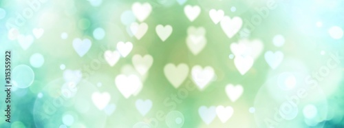 Abstract pastel background with hearts - blurred bokeh lights - 315355922