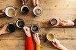 Leinwanddruck Bild - Friends group drinking coffee and cappuccino in a bar or restaurant - People hands cheering and toasting on top view point - breakfast together concept with white and black men and women