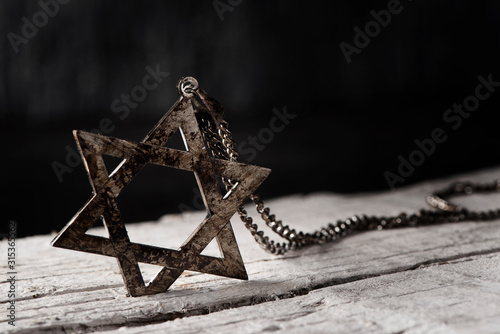 Fototapeta the star of david on a rustic wooden surface