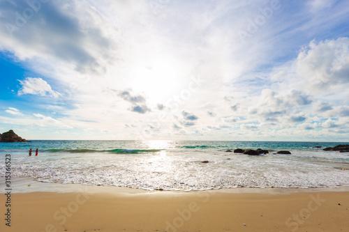 Beautiful sea wave on sandy beach evening sunset light