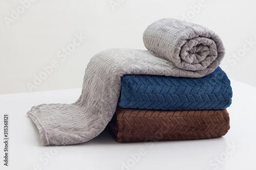 Leinwand Poster stack of folded soft blankets