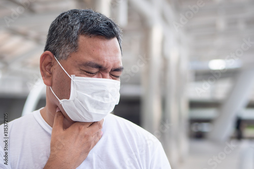 allergic sick old man having sore throat inflammation; concept of man with aller Wallpaper Mural